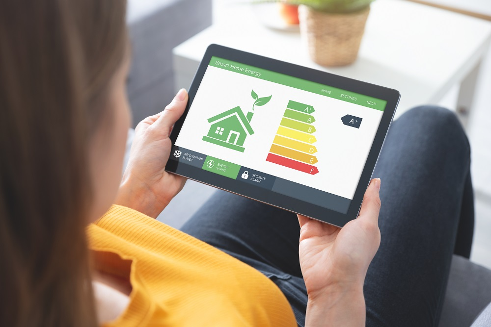woman looking at home energy assessment results on a tablet