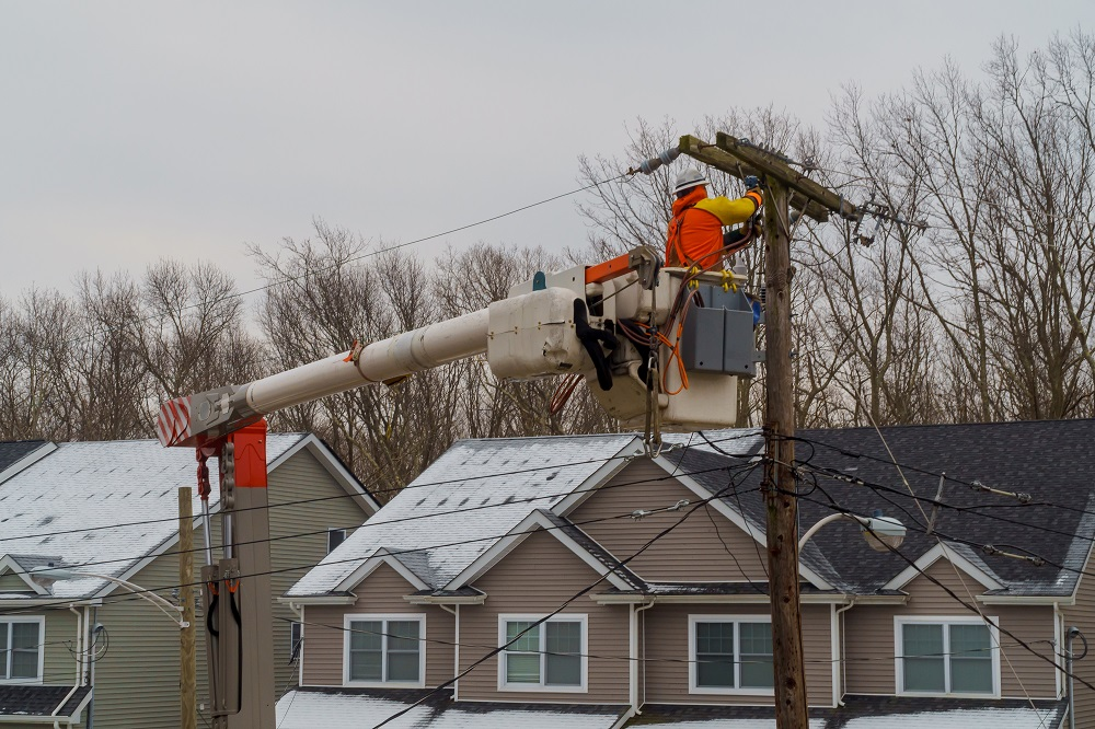 electric company working on power lines after a winter storm