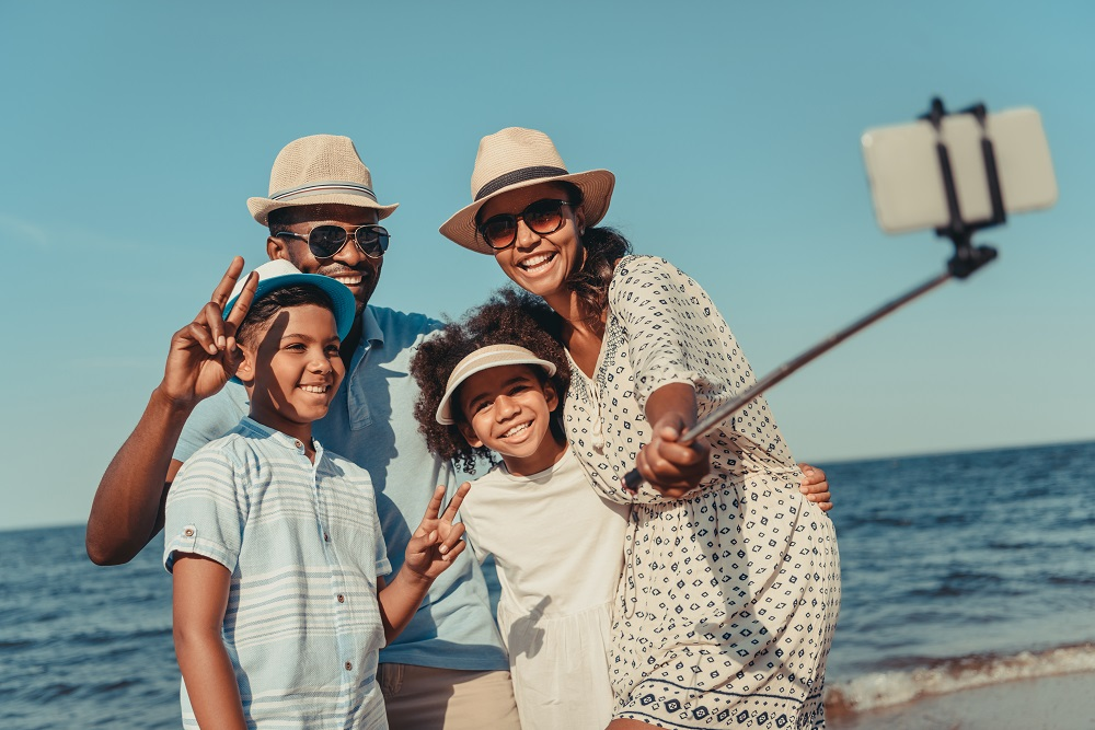 family on the beach taking a selfie
