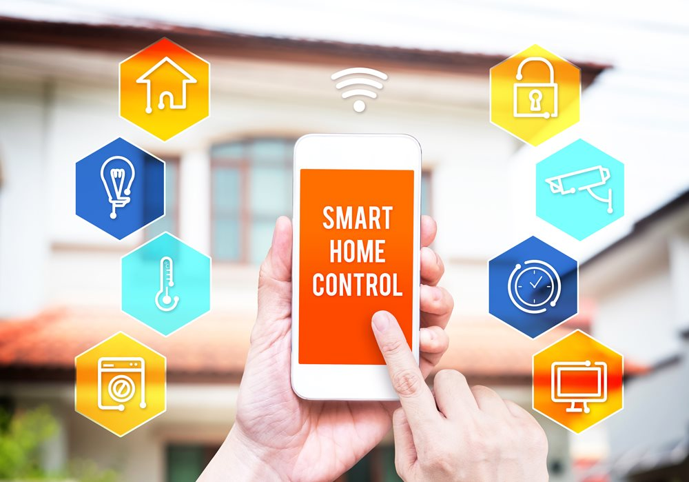 Hand holding smart phone with home control application with blur